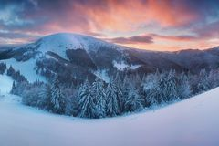 Panoramic view of beautiful winter wonderland mountain scenery in evening light at sunset. Mountains above the clouds. Christmas stock photo