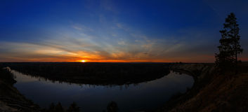 Panoramic view of bend in the river on background sunset. Stock Image