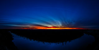 Panoramic view of bend in the river on background sunset. Stock Photos