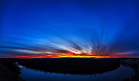 Panoramic view of bend in the river on background sunset. Royalty Free Stock Photos