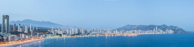 Panoramic view of Benidorm at dusk, Spain Stock Photos