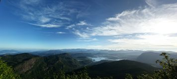 Panoramic view of blue sky and green mountains Royalty Free Stock Photo