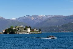 Panoramic view of boat and island in Northern Italy lakes area royalty free stock images