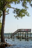 Panoramic View of Boat Lift in a Lake. On Blur Background. Niceville, Florida royalty free stock photos