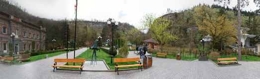 Panoramic view of Borjomi, Samtskhe-Javakheti, Georgia. arch Entrance To Pavilion Above Hot Spring Of Borjomi Mineral Water. Famous Local Landmark Is City Park Stock Photography