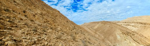 Holy land Series - The Big Crater HaMakhtesh Gadol 7. A panoramic view of the bottom Big Crater Hamakhtesh Hagadol in the Negev. Here is what Wikipedia has Stock Images