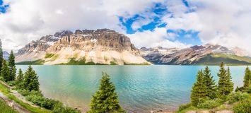 Panoramic view at the Bow lake with Portal Peek in Banff National Park - Canadian Rocky Mountains. Panoramic view at the Bow lake with Portal Peek in Banff royalty free stock image