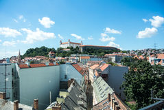 Panoramic view of Bratislava, a capital of Slovakia, old houses with tile roofs and a castle. A symbol of the city Royalty Free Stock Photography