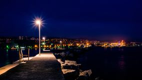 Panoramic view from the breakwater, entrance to the Port of Rijeka..Night shoot, Rijeka, Croatia. royalty free stock photos