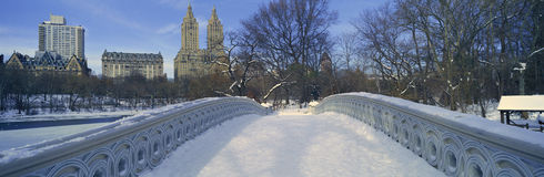 Panoramic view of bridge over frozen pond in Central Park, Manhattan, NY on upper west side near Central Park West Royalty Free Stock Photo