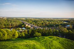 Panoramic view of bridge over river Klyazma in Vladimir city with railroad and green trees royalty free stock image