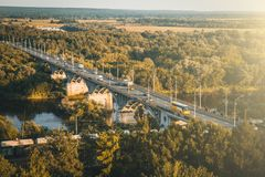 Panoramic view of bridge over river Klyazma in Vladimir city with railroad and green trees in summer day, toned royalty free stock photography