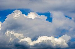 Panoramic view of bright picturesque white clouds on blue sky background Stock Image