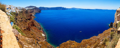 Panoramic view on a bright Sunny day on Bay and sea cliff with height of Oia, Santorini, Greece Royalty Free Stock Photography