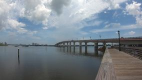 Panoramic view of Broadway Bridge on lightblue cloudy sky background.