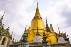 Panoramic view of the Prasat Phra Thep Bidon and the Golden Chedi in Wat Phra Kaew Complex. Bangkok, Thailand. royalty free stock photos