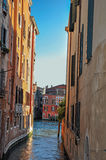 Panoramic view of buildings on a canal that ends on another canal at the sunset in Venice. Royalty Free Stock Photos