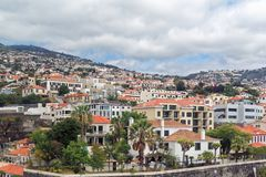 Panoramic view at buildings in Funchal on Madeira island. Panoramic view at buildings in Funchal city on Portuguese island of Madeira stock photos