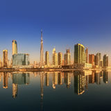 Panoramic view of Business bay and downtown area of Dubai, reflection in a river, UAE Stock Photo