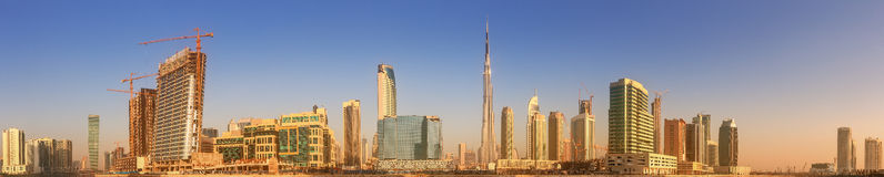 Panoramic view of Business bay and downtown area of Dubai, reflection in a river, UAE Royalty Free Stock Images