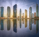 Panoramic view of Business bay and Lake Tower, reflection in a river, Dubai UAE Stock Photo
