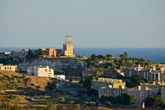 Panoramic view of Cagliari with the airport control tower. The sea and some buildings Stock Image