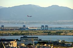 Panoramic view of Cagliari with a landing airplane stock photo