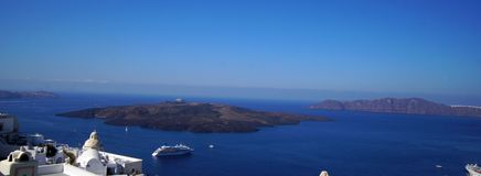 Panoramic view of the Caldera with cruise ship in Santorini. Greece stock photo