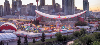 Panoramic view of the the Calgary Stampede at sunset. CALGARY, CANADA - JULY 8: Panoramic view of the the Calgary Stampede at sunset on July 8, 2016 in Calgary Royalty Free Stock Images