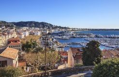 Panoramic view of Cannes city, France. Panoramic view of Le Suquet- the old town, Port Le Vieux and La Croisette of Cannes, France Royalty Free Stock Image