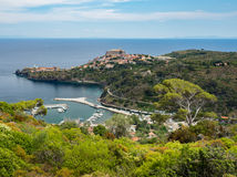 Panoramic view of Capraia town and harbour with Elba, Italy Royalty Free Stock Photography