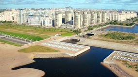Car moving on highway tunnel under water dam on background city landscape. Panoramic view car moving on highway tunnel under water dam through residential area stock video