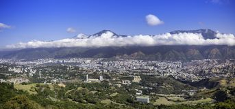 Panoramic view of Caracas Venezuela. With the Avila mountain in the north of the city in a sunny day with beautiful clouds on a blue day, amphitheater, ancient royalty free stock photography