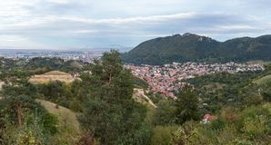 Panoramic view from the Carpathian Mountains to the Brasov city in  Romania. Royalty Free Stock Photography