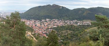 Panoramic view from the Carpathian Mountains to the Brasov city in  Romania. Royalty Free Stock Photos