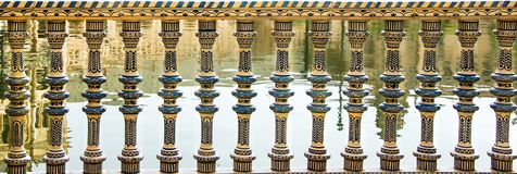 Panoramic view of carved stone balcony balustrade. Architecture details. Andalusian style royalty free stock photos