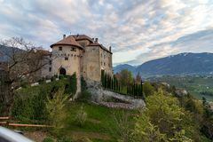 Panoramic view on Castle Schenna Scena near Meran during sunset. Schenna, Province Bolzano, South Tyrol, Italy royalty free stock photography