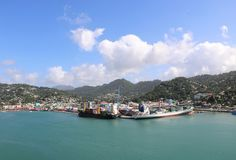 Castries, Saint Lucia. Panoramic view of Castries, the capital of Saint Lucia, with two ships in the cargo port and the city centre on the left. In the Royalty Free Stock Images