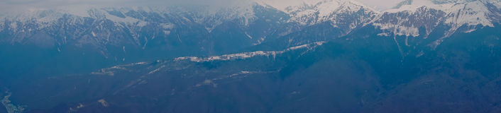 Panoramic view of the Caucasus mountains in the cloudy winter weather Royalty Free Stock Photo