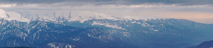 Panoramic view of the Caucasus mountains in the cloudy winter weather Royalty Free Stock Images
