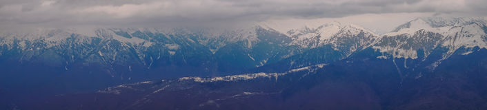 Panoramic view of the Caucasus mountains in the cloudy winter weather Stock Images