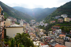 Panoramic view from the center of Riomaggiore with mountains on the background, Riomaggiore, Cinque Terre, Italy Stock Images