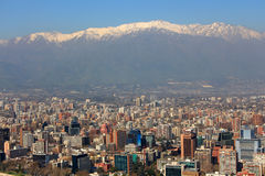 Panoramic view of the center of Santiago de Chile at evening with snowy Andes in the background Royalty Free Stock Photography
