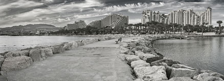 Panoramic view on the central beach of Eilat. Black and White filter was used for inspiration of retro style Royalty Free Stock Images