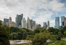 Panoramic view from Central Park to Manhattan skyscrapers at sunny day. New York City. NEW-YORK, USA - SEPTEMBER 29, 2009: Panoramic view from Central Park to stock image