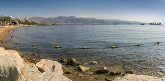 Panoramic view on central public beach in Eilat, Israel Royalty Free Stock Images