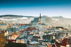 Cesky Krumlov in winter, Czech Republic, Europe. Panoramic view of Cesky Krumlov in winter, Czech Republic. View of the snow-covered red roofs. Travel and Stock Photo