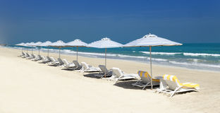 Panoramic view of chairs on the beach. Panoramic view of chairs and nices umbrella on the beach stock images