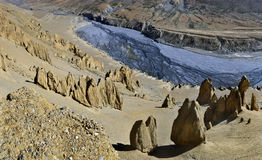 Panoramic view of the channel of high mountains: a deep canyon canyon from a sedimentary sandy yellow rock with weathering forms,. Below - the blue river bed Stock Photo