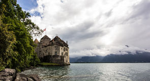 Panoramic view of  Chateau de Chillon at Lake Geneva, one of Switzerland`s most visited castles in Europe, with sky full of cloud Royalty Free Stock Photos